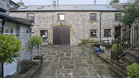 Markeygate House as seen from the large York stone flagged courtyard. Stone steps with wrought iron rails lead to the...