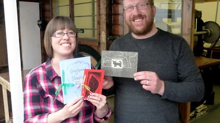 Emma and Duncan Pass with examples of books written and produced by students at one of their classes