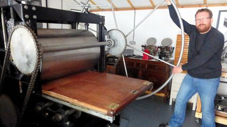 Duncan Pass with his homemade printing press
