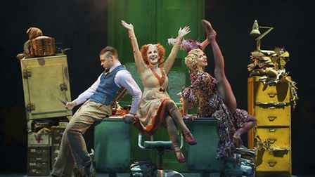 Jonny Fines as Rooster, Lesley Joseph as Miss Hannigan and Djalenga Scott as Lily in Annie, on stage in Nottingham this...