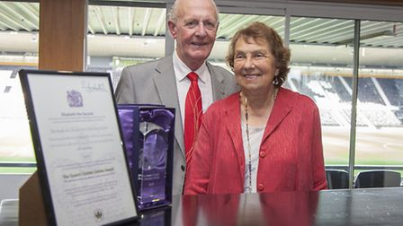 Bill Tomlinson with his wife Delphine at the presentation of the Queen's Award for Voluntary Service to DCHC