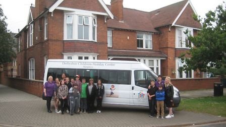 The hand-over of a new minibus at DCHS's Skegness home