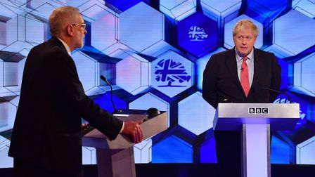 Boris Johnson and Labour leader Jeremy Corbyn (left) going head to head in the BBC Election Debate.