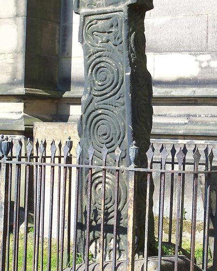 The west face of the Bakewell Cross shows a horseman in the centre with a squirrel perched above the carved vine scrolls