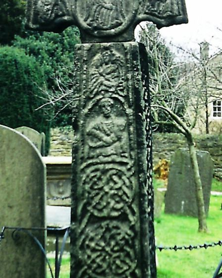 The west face of the superb Eyam Cross incorporates human figures including angels and the Virgin and child. Note that the...