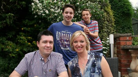 Rachel at home with her family: Henry aged 12, Joe aged 17, and partner Chris Mapp Photo: Penelope Baddeley