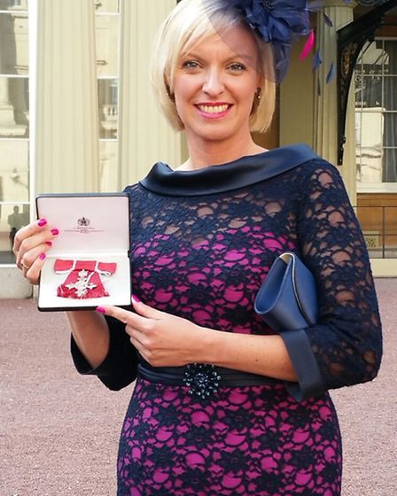 Rachel with her MBE at Buckingham Palace