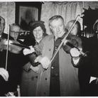 Foolow Carollers at Home Farm, run by Emily and Joe Redfearn, Christmas Day 1957 Photo Village Carols Archive