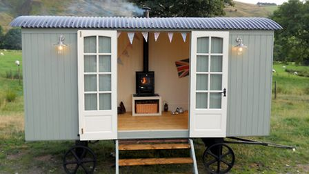 A shepherd's hut with a wood-burning stove