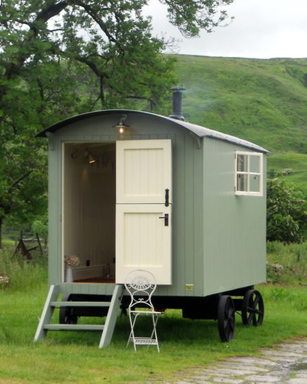 A shepherd's hut with a rear-opening stable door