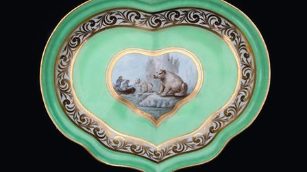 Derby porcelain dish, painted by John Brewer showing the hunting of Polar Bear in the Arctic, c.1800 Photo: Derby Museums