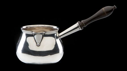Silver brandy pan formerly belonging to Sir Richard Arkwright, made by Henry Chawner in 1787 Photo: derby Museums
