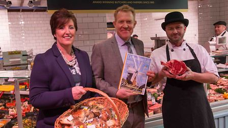 Carole Robinson, Denby's Retail Operations Controller, Adam Henson of BBC One's Countryfile of holding his copy of...