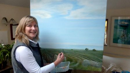 Sue Lewis-Blake working on a painting with the provisional title ?Field and Footpath?