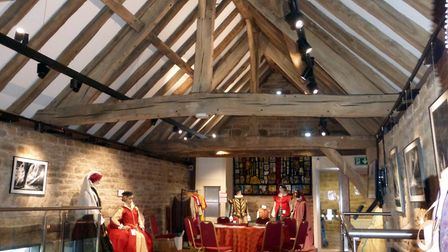 The restored timbered gallery of Dronfield Hall Barn with part of Maureen Taylor's costume exhibition