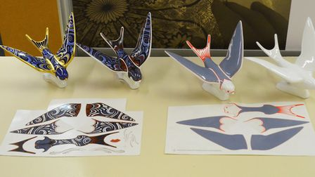 A swallow paperweight and the lithographs required to build the intricate pattern