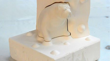 A British Bulldog paperweight emerges from its mould