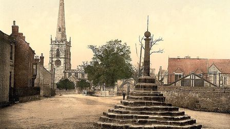 Around 100 years ago. Repton Cross replete with spike and not yet a roundabout - the only vehicle a horse and cart