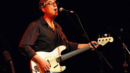 Graham on stage in Buxton in 2009 with 10cc