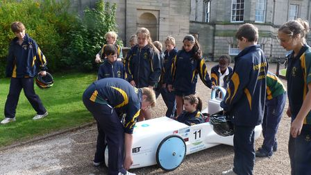 Pupils working on one of the Greenpower cars