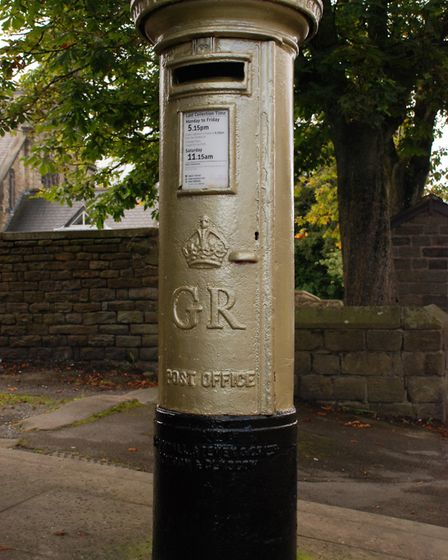 Golden Moment - pillar box in Chapel-en-le-Frith painted in honour of 2012 Paralympics Gold Medallist Anthony Kappes...