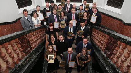 Winners and judges gather on the grand staircase