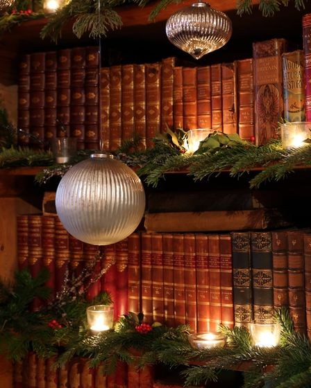 Even the bookcases are trimmed up with tasteful décor