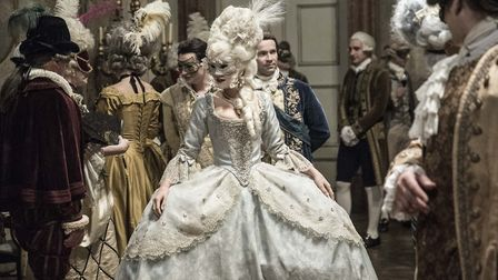 The magnificent costumes and makeup are shown to advantage in the masked ball scene