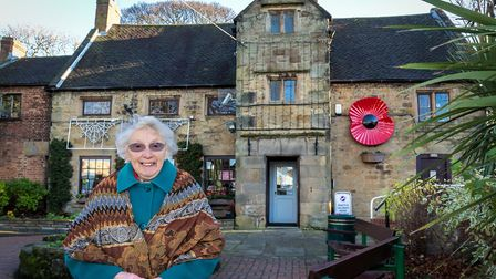 Marlene Bennett MBE, Mayor of Alfreton six times and a Town Councillor for 33 years. Behind her is Alfreton House.