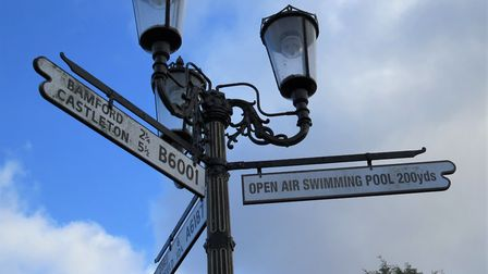 3-lamp sign at the junction of Hathersage's Main Road