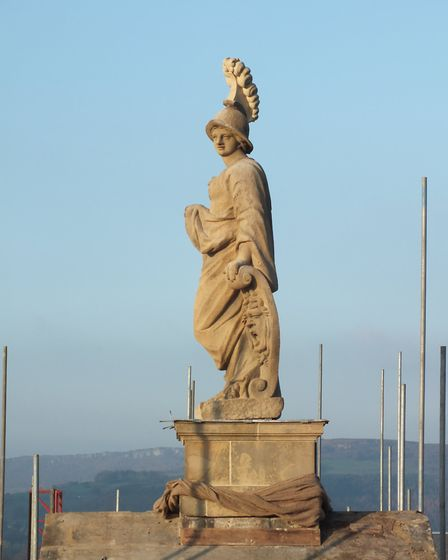 The rooftop statue of Minerva after cleaning