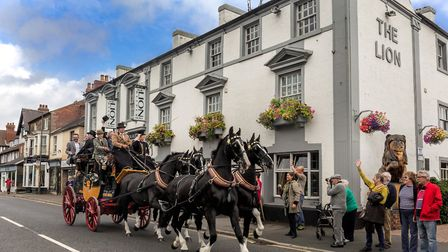The Tantivy stagecoach passing the Lion Hotel on its commemorative trip from Belper to Cromford, raising money for the...