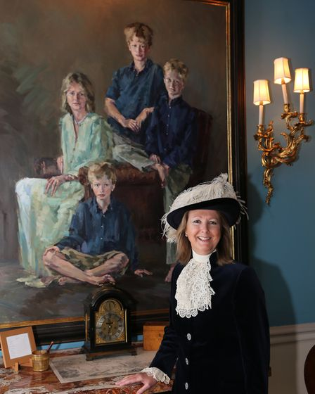 High Sheriff Lucy beside her favourite family portrait