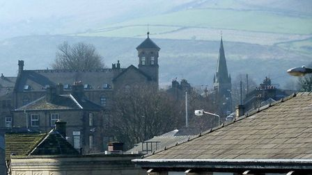 Hills of the High Peak over the rooftops of Glossop by Mike Smith