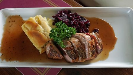 Gressingham duck breast with red cabbage and dauphinoise potatoes