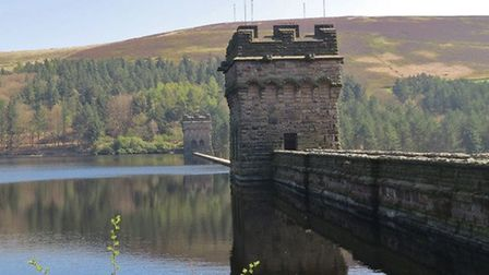 Twin turrets of Derwent Dam by Sally Mosley