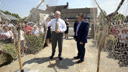 HRH The Duke of Gloucester and Richard Cook, managing director of Severn and Wye Smokery, move two lave nets to officially...