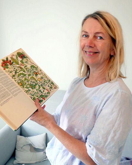 Katharine Towers with a copy of ?The Concise British Flora in Colour? by W Keble Martin