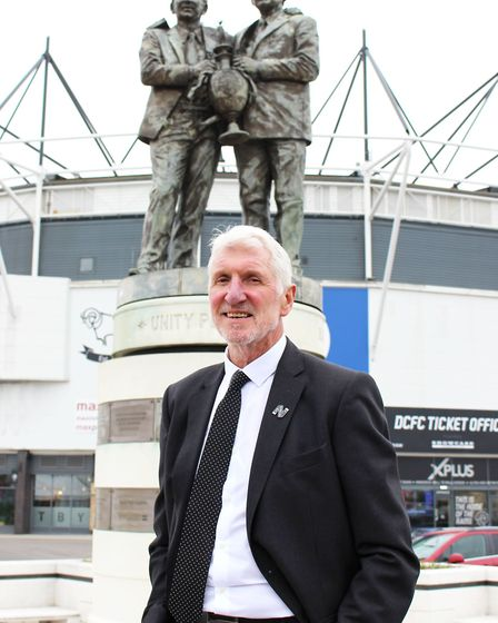 Roger in front of Pride Park's statue of Brian Clough and Peter Taylor