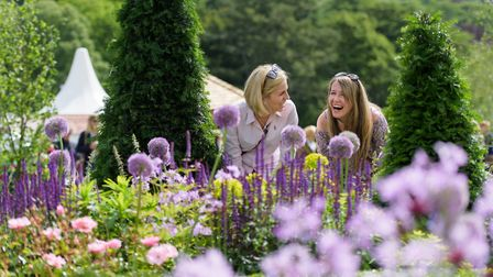 Visitors look at the Experience Peak District & Derbyshire Garden at RHS Chatsworth Flower Show