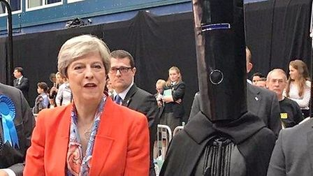Lord Buckethead alongside Theresa May. Photograph: PA.