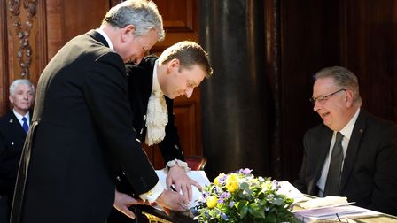 Lord Burlington signs one of several legal documents