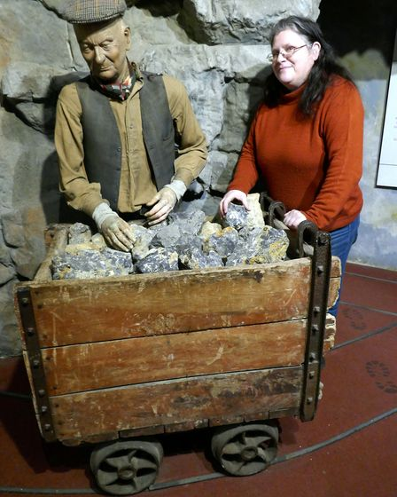 Clare Herbert, Museum Administrator with one of the exhibits at the Peak District Mining Museum