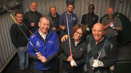 Head golf professional Steve Hadfield with Caroline Bradley and Geoff Parkes, flanked by other members