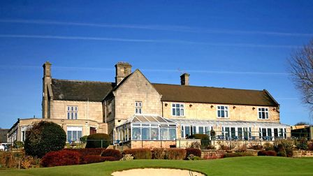 Horsley Lodge in its attractive setting with surrounding golf course