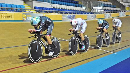 Team HUUB Wattbike show off their team and National Champions kit on the track