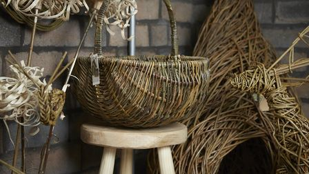 Examples of Rachels baskets showing a Welsh Cyntell shopping basket and a pod sculpture