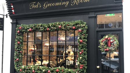 Ted's Grooming Room in Marylebone, London, dressed for Christmas with a garland and door wreath by Jilly
