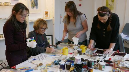 Participants in a calligraphy printmaking course: Mo; Ginni, Nikki Dennett (Workshop Leader) and Rachel