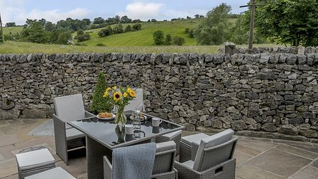 Relaxing outside at The Water Mill with its peaceful rural surrounds
